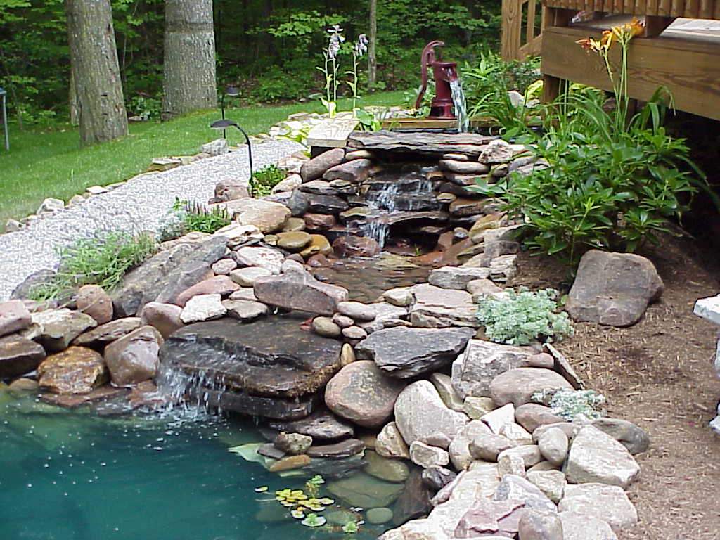 Backyard pond and waterfall on pinterest ponds koi for Garden designs with water features